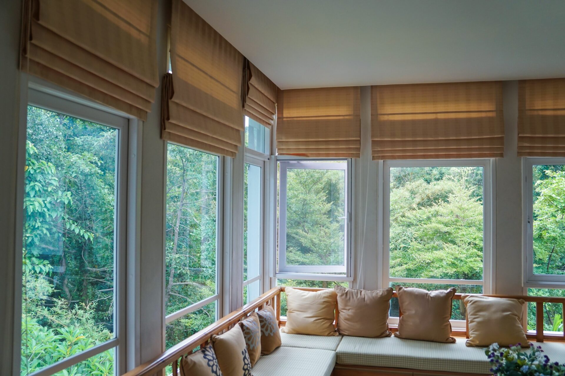 Warm, earthy color of Roman shades is iconic for Boho-inspired decoration