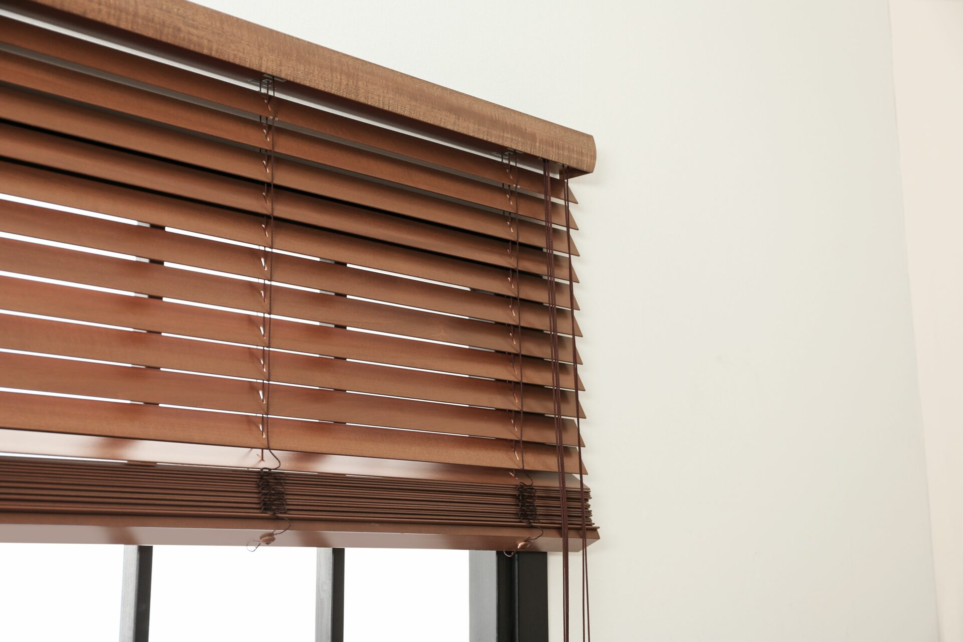 Faux wood blind is ideal option for bathroom